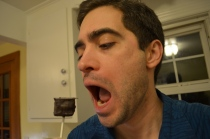 Home confectioner eating a chococaramallow pop